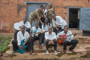 Members of Malawi's Zomba prison project band pose for a photograph outside the Central Prison's makeshift music studio. (AFP/Amos Gumulira)