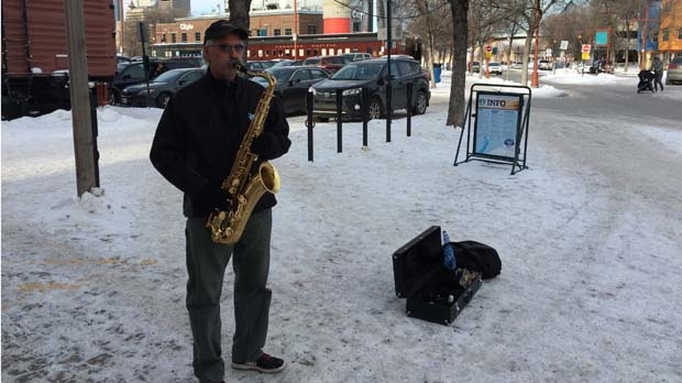 -40 C windchills didn't deter this busker at The Forks on Saturday, Jan. 16, 2016.