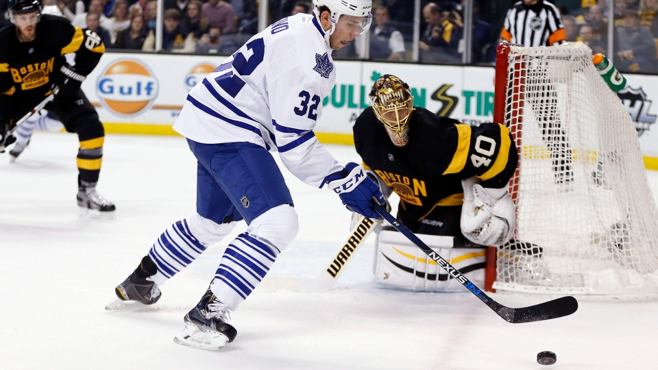 Toronto Maple Leafs' Josh Leivo (32) tries to get a shot off on Boston Bruins' Tuukka Rask (40) during the first period of an NHL hockey game in Boston, Saturday, Jan. 16, 2016. (AP Photo/Michael Dwyer)