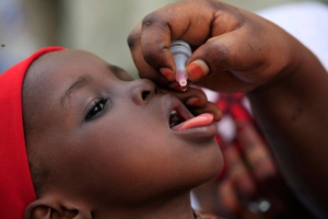 In this Sunday, April 13, 2014 file photo, a health official administers a polio vaccine to a child in Kawo Kano, Nigeria. (Sunday Alamba / AP Photo)