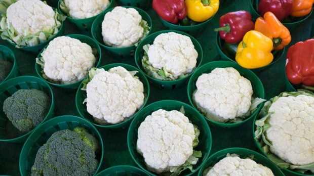 Cauliflower surrounded by broccoli and peppers is seen at  Montreal market on January 11, 2016.(Paul Chiasson / THE CANADIAN PRESS)