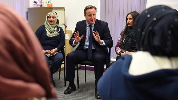 Britain's Prime Minister David Cameron, centre