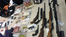 Weapons and drugs displayed