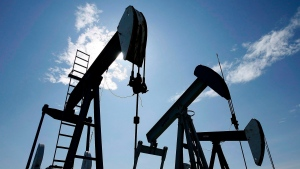 Pumpjacks pump crude oil near Halkirk, Alta., June 20, 2007. (Larry MacDougal / The Canadian Press)