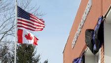Canadian flag at fire department in Genesio, N.Y.