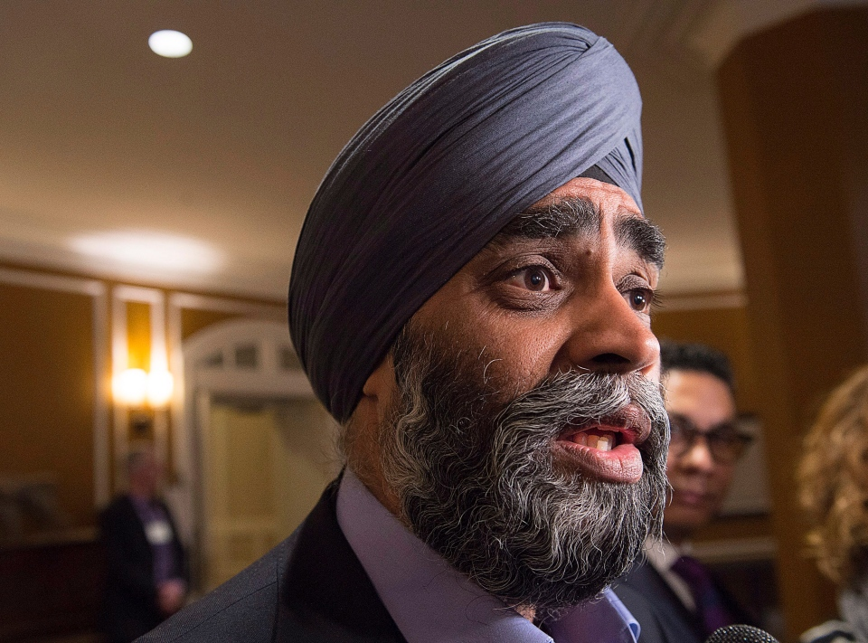Defence Minister Harjit Sajjan talks with reporters before a morning session at a cabinet retreat at the Algonquin Resort in St. Andrews, N.B. on Monday, Jan. 18, 2016. (Andrew Vaughan / THE CANADIAN PRESS)