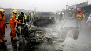 Pakistani fire fighters try to extinguish a vehicle on fire following a suicide blast, in Peshawar, Pakistan on Tuesday, Jan. 19, 2016. (AP / Mohammad Sajjad)