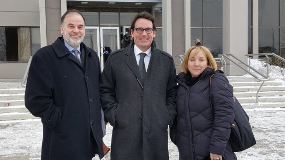 Pierre Duchesne, Pierre Karl Peladeau and Annick Belanger (Peladeau's communications director) arrive at UQAC on Tuesday, Jan 19, 2016 (Photo: Twitter.com/PKP_Qc)