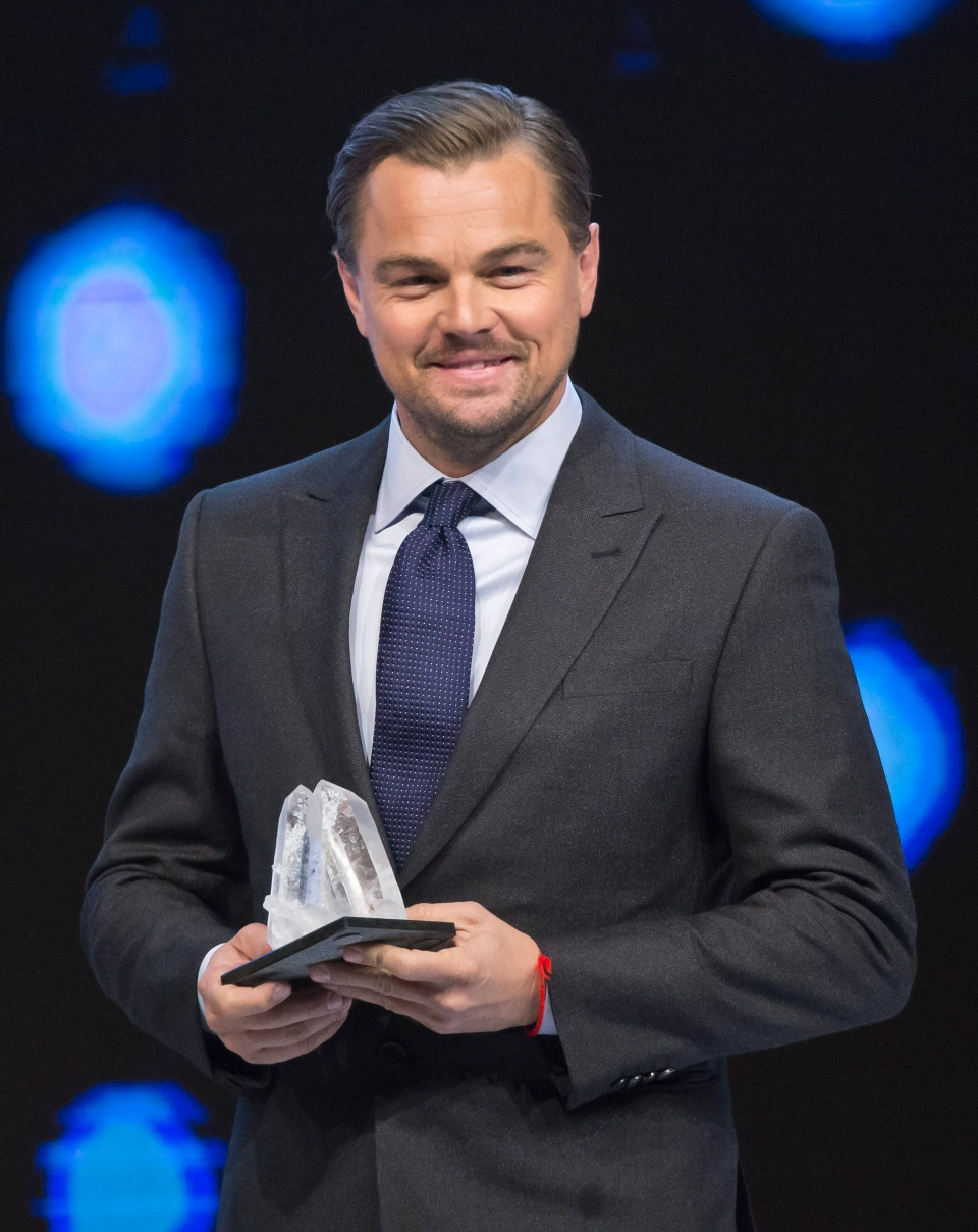 U.S. actor Leonardo DiCaprio smiles as he is awarded the Crystal Awards during the World Economic Forum in Davos, Switzerland, Tuesday Jan. 19, 2016. (AP Photo/Michel Euler)