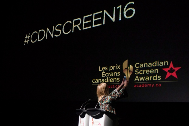 Presenter Liz Trinnear takes a selfie as she stands at the podium at the announcement of the nominations for the Canadian Screen Awards at Toronto's Tiff LightBox, on Tuesday, January 19, 2016. (THE CANADIAN PRESS / Chris Young)