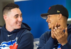 Toronto Blue Jays Aaron Sanchez, left, and Marcus Stroman laugh as they take part in the Jays Care Foundation after a media availability in Toronto on January 19, 2016. (Nathan Denette / The Canadian Press)