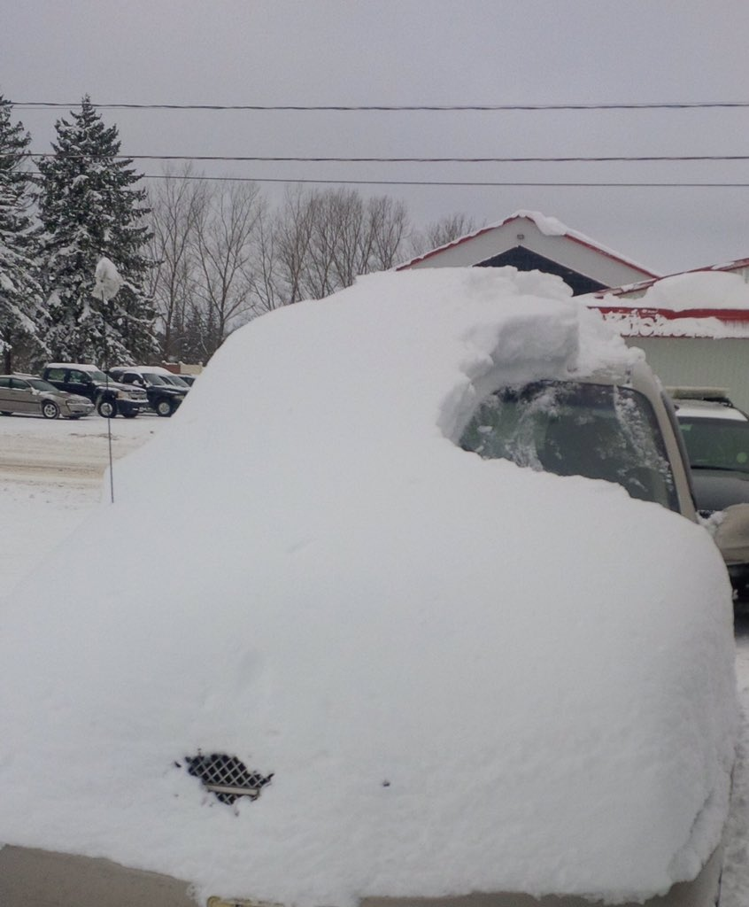 Police say the driver of this car in Brussels, Ont. was charged for failing to clean his vehicle on Tuesday, Jan. 19, 2016. (@OPP_WR / Twitter)