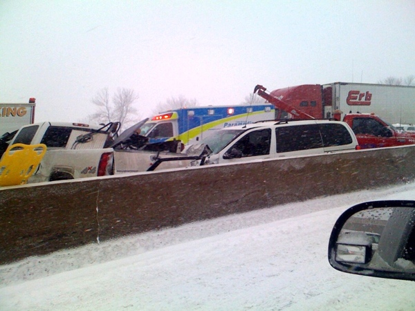 Emergency vehicles respond to a vehicle crash along Hwy. 400, north of Toronto, Friday, Dec. 19, 2008. (Veronica Nuspl / MyNews.CTV.ca)