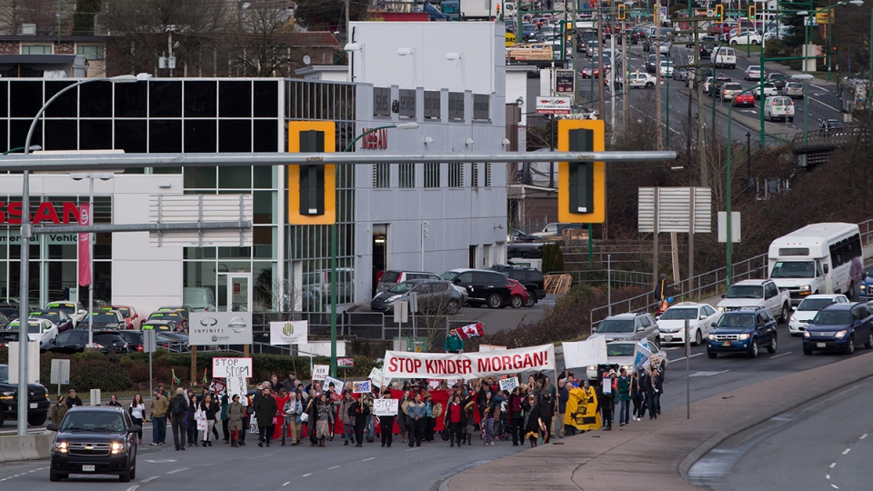 Protesters march to a demonstration outside National Energy Board hearings on the proposed Trans Mountain pipeline expansion in Burnaby, B.C., on Tuesday, Jan.  19, 2016. (Darryl Dyck / THE CANADIAN PRESS)