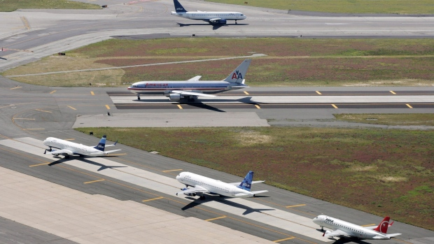Planes taxi on runways at John F. Kennedy International Airport in New York on Sept. 8, 2008. (AP / Mark Lennihan)