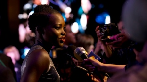 In this file photo, Kenyan actress Lupita Nyong'o answers questions from TV journalists at a fan event to promote 'Star Wars: The Force Awakens,' at Antara Fashion Mall in Mexico City, Tuesday, Dec. 8, 2015. (AP Photo / Rebecca Blackwell)