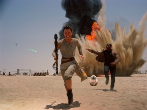 "This photo provided by Disney shows Daisey Ridley as Rey, left, and John Boyega as Finn, in a scene from the new film, ""Star Wars: The Force Awakens,"" directed by J.J. Abrams. (Film Frame / Disney / Lucasfilm via AP)"