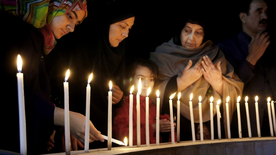 Pakistani women light candles during a vigil for victims of the Bacha Khan University attack in Peshawar, Pakistan on Wednesday, Jan. 20, 2016. (AP / Mohammad Sajjad)