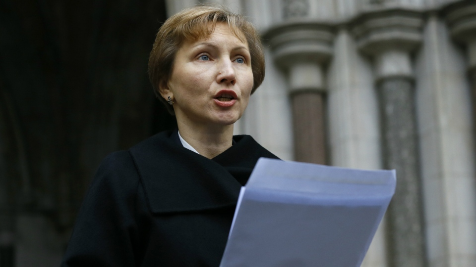 Marina Litvinenko, widow of former Russian spy Alexander Litvinenko, reads a statement outside the Royal Courts of Justice in London on Thursday, Jan. 21, 2016. (AP / Kirsty Wigglesworth)