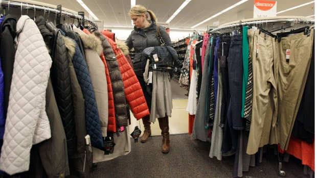 In this Thursday, Nov. 1, 2012 file photo, a shopper checks winter jackets in a Nordstrom rack in Chicago. (AP Photo/Nam Y. Huh)