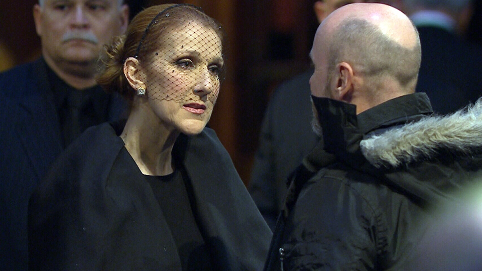 Celine Dion speaks to a person paying respects at the visitation for Rene Angelil at Notre-Dame Basilica, in Montreal, Thursday, Jan. 21, 2016.