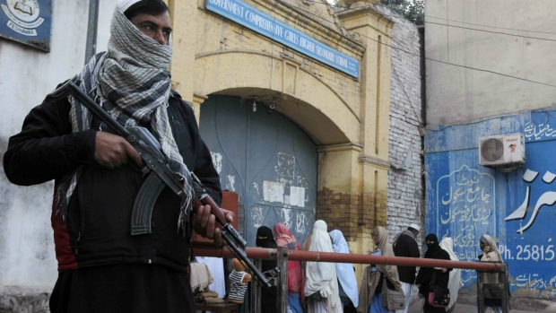 Security guards on patrol around Pakistan schools