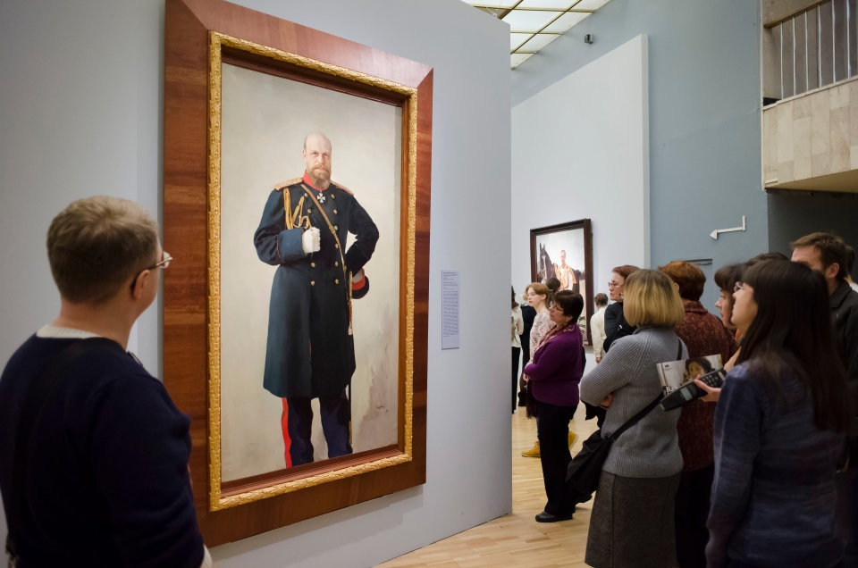In this photo taken on Sunday, Jan. 10, 2016, visitors look at a painting by Valentin Serov at the exhibition of his works in the Tretyakov Gallery in Moscow, Russia. (AP Photo/Alexander Zemlianichenko)