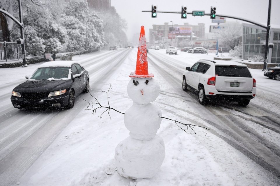 A snowman stands on a traffic median. Friday, Jan. 22, 2016, in Nashville, Tenn. (Andrew Nelles / The Tennessean)