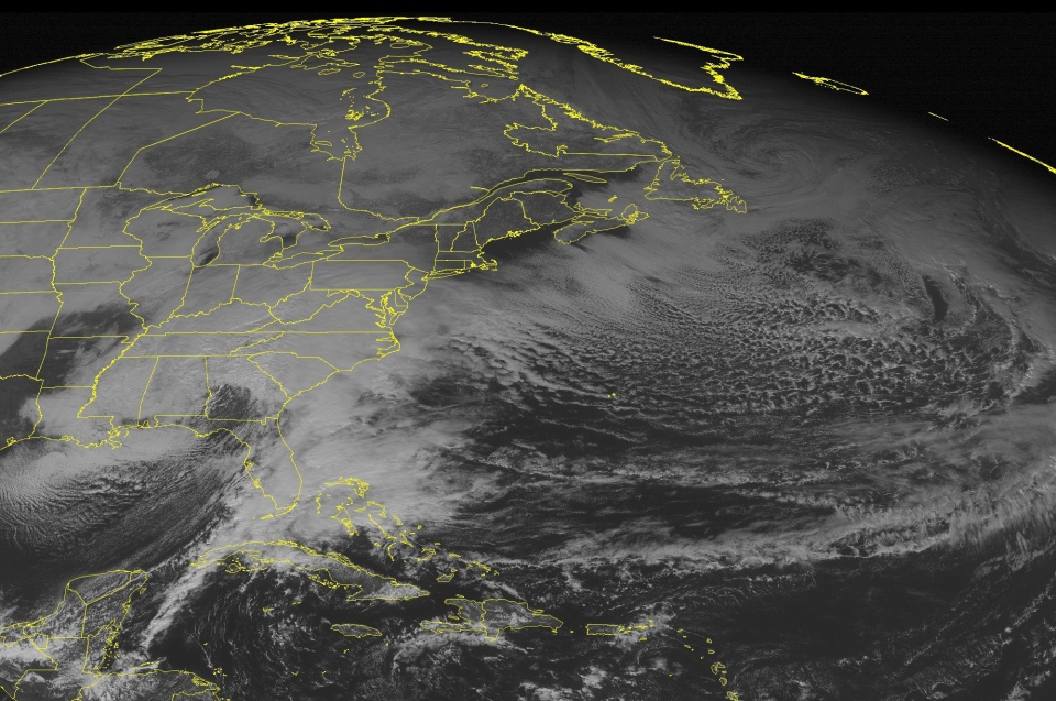 This NOAA satellite image taken Friday, Jan. 22, 2016 at 12:45 p.m. EST, shows a large strengthening winter storm system that is moving across the southeastern United States.