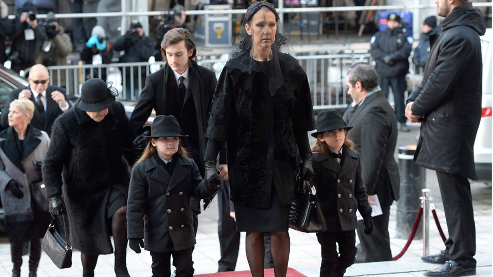 Celine Dion arrives with sons Eddy and Nelson for the funeral of her late husband Rene Angelil at Montreal's Notre-Dame Basilica on Friday, Jan. 22, 2016. (Ryan Remiorz / THE CANADIAN PRESS)
