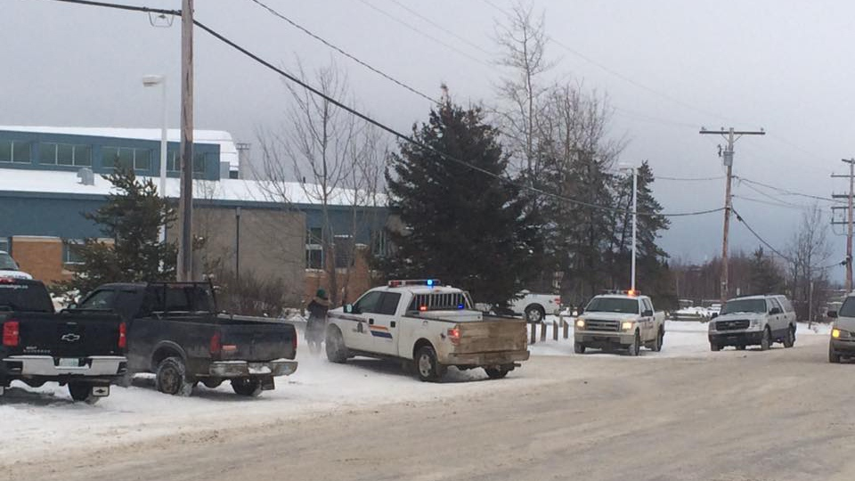 RCMP vehicles are seen here on scene Friday at Loche Community School's Dene Building. (Joshua Mercredi/Facebook)
