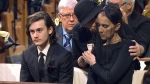 Celine Dion is comforted by her mother Therese next to Rene Angelil's son Rene-Charles at the funeral of her late husband at Montreal's Notre-Dame Basilica on Friday, Jan. 22, 2016.