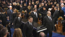Rene Angelil's casket leaves Montreal funeral