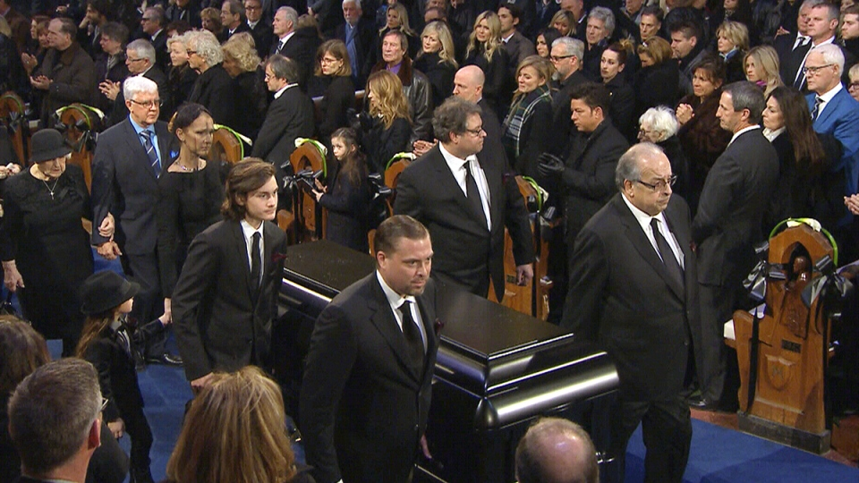 Rene Angelil's casket is carried out of Notre-Dame Basilica following his funeral in Montreal, Friday, Jan. 22, 2016.