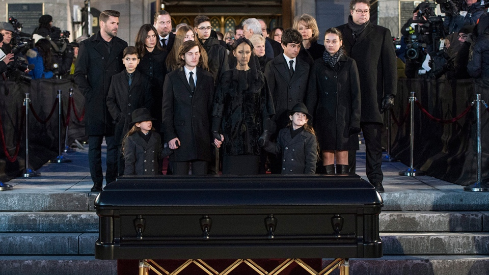 Celine Dion, with sons Eddy and Nelson, and Rene-Charles Angelil, stand before her late husband Rene Angelil's casket at Notre-Dame Basilica, in Montreal, Friday, Jan. 22, 2016. (Paul Chiasson / THE CANADIAN PRESS)
