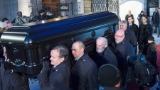 Celine Dion follows Rene Angelil's casket
