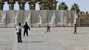 Tenting partially blocks the Luxor Temple in preparation for a visit by Chinese President Xi Jinping, as young boys play soccer, in Luxor, Egypt. (AP / Thomas Hartwell)