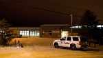 Police investigate the scene of a Friday afternoon shooting at the La Loche, Sask., junior and senior high school on Saturday, Jan. 23, 2016. The shooting left four people dead. THE CANADIAN PRESS/Jason Franson
