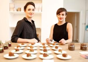 Katharina Unger and Julia Kaisinger showcase their bug dishes (AFP/Dieter Nagl)