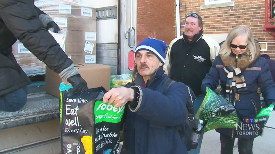 Second Harvest, a food redistribution organization, handed out baskets of groceries to former Goodwill workers who were laid off last week.