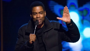 In this Feb. 28, 2015 file photo, comedian Chris Rock performs at Comedy Central's 'Night of Too Many Stars: America Comes Together for Autism Programs' in New York. (Photo by Charles Sykes / Invision / AP, File)