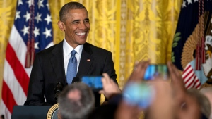 President Barack Obama smiles as he arrives to speak to mayors from around the country, Thursday, Jan. 21, 2016, in the East Room of the White House in Washington. (AP Photo / Carolyn Kaster)