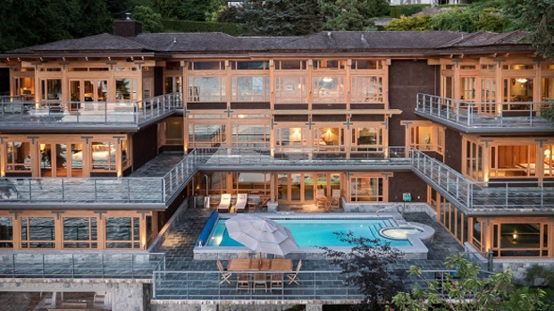 This 13,000-square-foot waterfront mansion in West Vancouver, B.C. comes complete with a garage for your yacht. But that's not all: the five-bedroom, seven-bathroom luxury home also includes indoor and outdoor swimming pools, a hot tub, a five-car garage, an elevator, an exercise facility, and more than 4,600 square-feet of deck. Interested? 5363 Kew Cliff Rd. could be yours for a cool $23.8 M. (Photos: Sotheby's International Realty Canada).