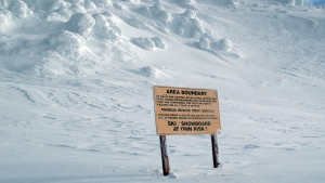 In this file photo, a warning is posted on top of the Gem Lake chair, telling skiers and snowboarders to stay away from the area out of boundaries Wednesday Jan. 19, 2011 at the Big White ski resort near Kelowna B.C. (THE CANADIAN PRESS / Jacques Boissinot)