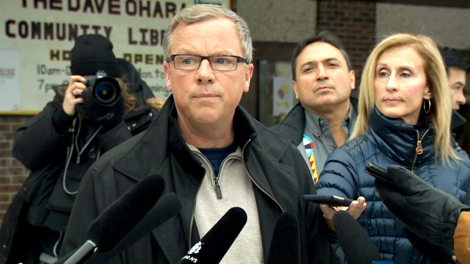 Saskatchewan Premier Brad Wall speaks to reporters in La Loche, Sask. on Sunday, Jan. 24, 2016.