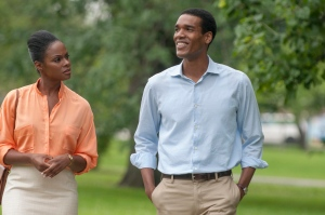 """This image provided by courtesy of the Sundance Institute shows, Tika Sumpter, left, as Michelle Robinson, and Parker Sawyers as Barack Obama, in the film, """"Southside With You,"""" directed by Richard Tanne. (Pat Scola/Sundance Institute via AP)"""