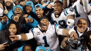Carolina Panthers' Cam Newton celebrates with teammates during the second half the NFL football NFC Championship game against the Arizona Cardinals Sunday, Jan. 24, 2016, in Charlotte, N.C. (AP Photo / Chuck Burton)