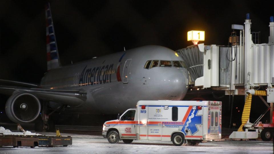 An ambulance departs St. John's International Airport on Sunday, January 24, 2016. (THE CANADIAN PRESS / Paul Daly)