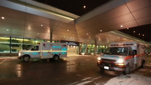 Ambulances are seen at St. John's International Airport on Sunday, January 24, 2016. (THE CANADIAN PRESS / Paul Daly)