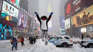 Bella Fraker stands on a snow pile in New York's Times Square, on an. 23, 2016. (Craig Ruttle / AP)